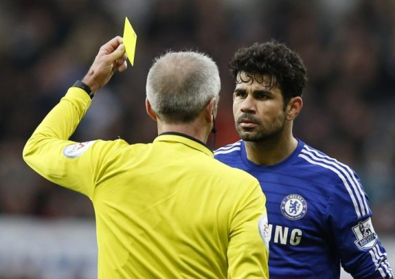 455428-chelseas-diego-costa-r-is-shown-a-yellow-card-by-the-referee-martin-at